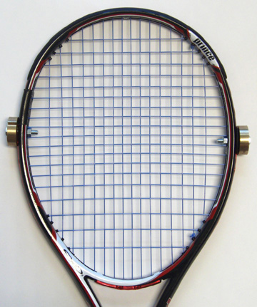Racquet with peripheral weights