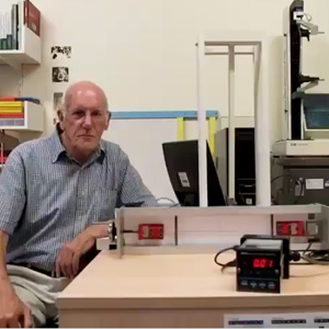 Rod Cross explains experiment setup.